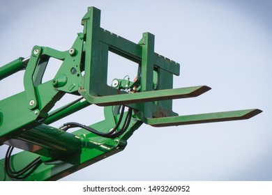 Part and detail of old forklift loader or stacker. Modern technology in industry or agriculture concept