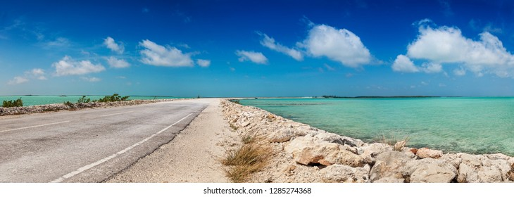 Part dirt, part pavement - the causeway between North and Middle Caicos curves through the shallow turquoise waters of the Caicos banks