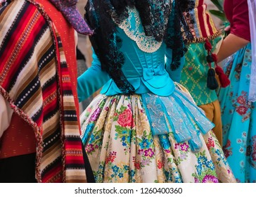 Part of the dress and costume of fallas people, during the floral offering to the virgin of the destitute, in the party of Fallas