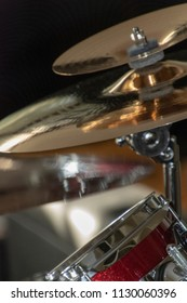 Part of a drum set in close up. Crash cymbal, splash cymbal and drum.