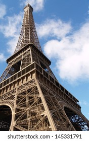 A part of Eiffel Tower on sunny day on blue sky background