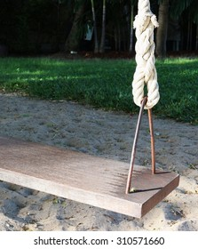 A part of empty swing on children playground with sunlight in the morning