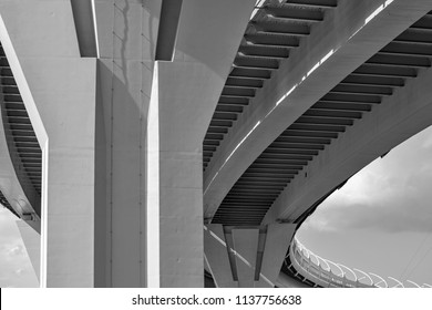 part of an engineering construction or structure of the big automobile bridge or viaduct with a reinforced concrete march and support closeup