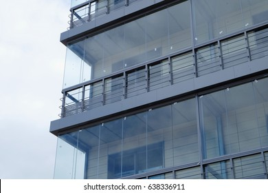 part of the facade of modern house with glass balconies