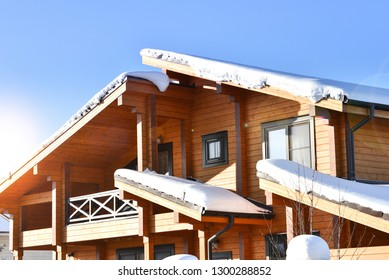 Part of the facade of a wooden house in modern style. Natural photo.