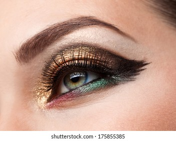 Part of face beautiful woman with brown eye make-up