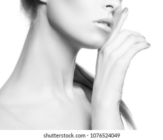 Part of face with lips, neck and hand of model girl. Natural nude make-up, perfect clean skin. Facial treatment concept. Isolated over white background. Black and white