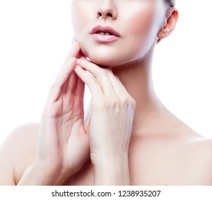 Part of face of young beauty model girl with perfect skin, natural lips, neck. Skincare health beauty treatment concept. White background