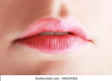 Part of face young woman close up. Sexy plump lips with little makeup