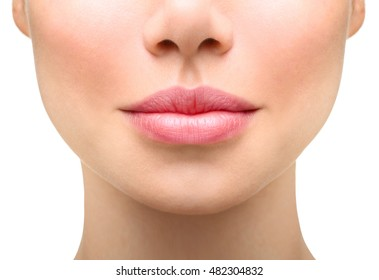 Part of face,young woman close up. Sexy plump lips without makeup