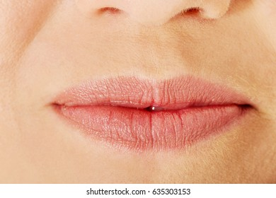 Part of face,young woman close up. Lips without makeup.