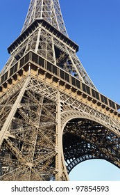 part of famous Eiffel tower with blue sky in Paris