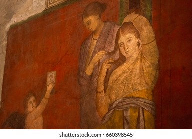 A part of fresco Dionysiac frieze in ruins of Ancient Roman city Pompeii, Campania region, Italy. City destroyed by eruption of Mount Vesuvius. Wall fresco in Villa of Diomede. A little noisy image.