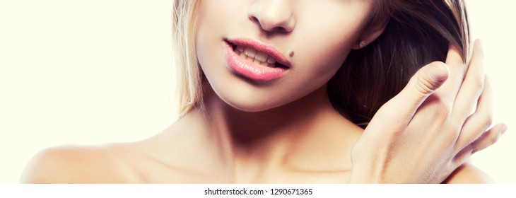 Part of girl face with nude make-up, natural lips, clean skin, naked shoulders