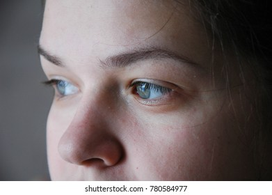 Part of the girl's face is close-up - eyes and nose.