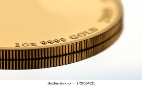 A part of a gold coin weighing 1 troy ounce. Selective focus.