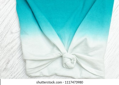 Part of the gradient T-shirt with a knot. Close-up, detail