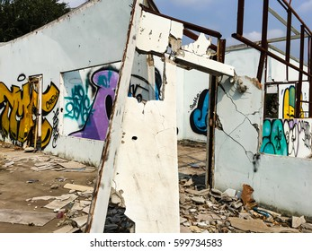 Part of graffiti on the abandoned construction in the city.