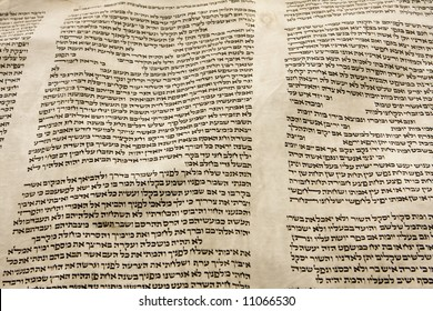 A part of the Hebrew text from a portion of a Torah scroll. This scroll is estimated to be 150 years old and is wrinkled and spotted with age.