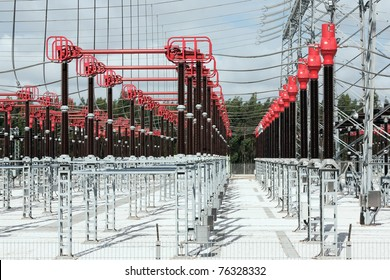 Part of High Voltage Station connectors against sky and woods