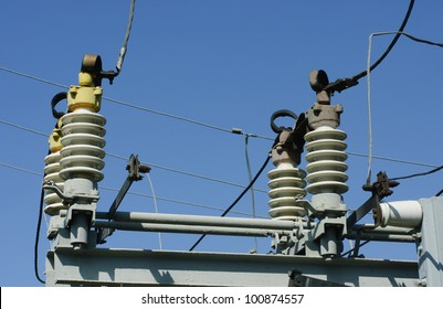 part of high-voltage substation on the blue sky background