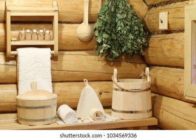 Part of the interior of the Russian bath and bath accessories. Bath accessories on the background of the log walls of the Russian bath.