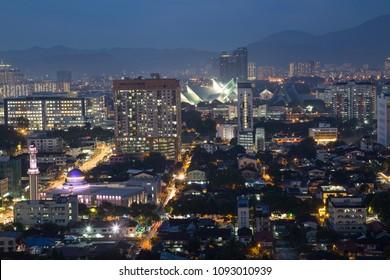 Part of the Kuala Lumpur Skyline at night towards the National Mosque of Malaysia (Masjid Negara)