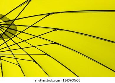 Part of lime coloured large patio / beach UV blocker umbrella
