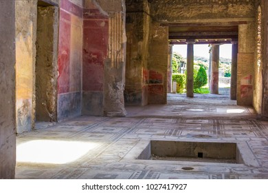 Part of the living room with frescoes painted on the walls in a ruined house in Pompeii, Naples, Italy. The ruins of the ancient city, excavations of Pompei scavi.