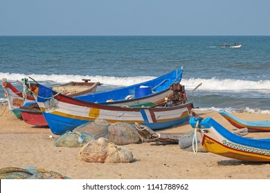Part of the local fishing fleet stranded on the beach at Mamallapuram in Tamil Nadu, India. The main catches taken in the Bay of Bengal inshore fishery are pomfrets and prawns