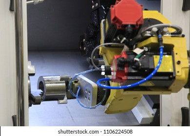 Part machining on CNC lathe with industrial robot