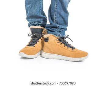 Part of male legs in winter boots - over white background