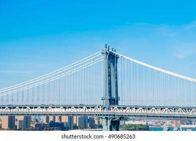 Part of Manhattan Bridge, New York with clear blue sky