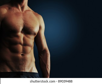 Part of a man's body on a dark blue background with copyspace