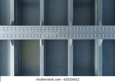 Part of a massive metal structure with rivets