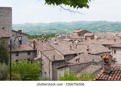 Part of medieval city with storical stones constructions and little church from the top of Gubbio