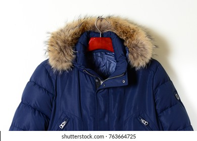 Part of men's jackets winter blue hooded fur, fastened with a zipper. Winter collection of men's clothing 2017-2018