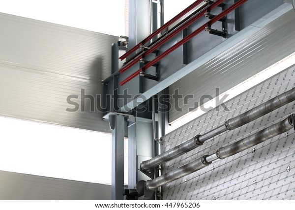 part of the metal structures of the gate within an industrial building