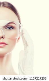 Part of model woman face with beautician doctor gloves and dantist glasses