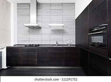 Part of modern minimalism style kitchen interior in monochrome tones