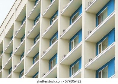 part of a modern multi-storey office building with balconies and windows