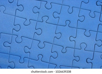 Part of a mosaic of blue paper puzzles