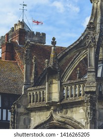 Part of Old Gothic Architecture with Waving English Flag in Background, shallow depth of field vertical photography