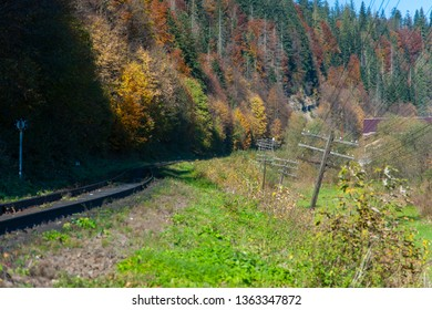 Part of the old railway near the forest and mountains. It was autumn weather and scenery.