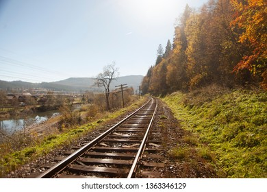 Part of the old railway in the small village near the forest and mountains.