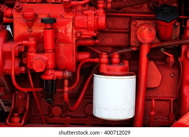 Part of old tractor engine painted in red color