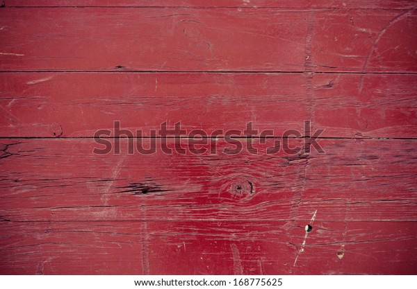 Part of a old woodboard texture painted on red.