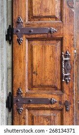 Part of old wooden door with handle and hinges