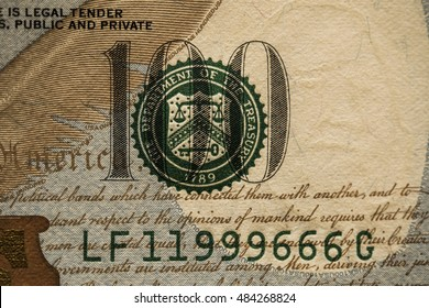 Part of one hundred dollar bill in macro. 666 number