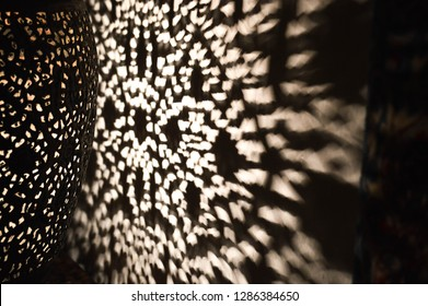 a part of oriental lamp with bokeh lights on wall